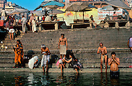 Varanasi, India, JAN 1989: Varanasi, also known as Benares, is a city situated on the banks of the river Ganges in the state of Uttar Pradesh in North India. The Ganges or Ganga is considered as the most sacred river in India and is worshipped as Goddess Ganga. The water of the Ganges is considered very pure and that it washes away ones sins and cures diseases. Millions of pilgrims visit Varanasi every year for the ritual bath in the holy water. One third of India's population lives along the banks of the 1560 mile long river. The Ganges is also one of the most polluted rivers in the world. In Dec 2009 The World Bank donated one billion dollars to the Indian government to clean up the heavily polluted river.