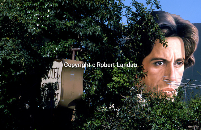 Al Pacino billboard for the movie Bobby Deerfield neat the Chateau Marmont sign on Sunset Blvd. circa 1977
