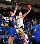 SIOUX FALLS, SD - NOVEMBER 28: Alex Arians #34 from South Dakota State University takes the ball to the basket against Danny Dixon #4 from UMKC during their game Wednesday night at Frost Arena in Brookings, SD. (Photo by Dave Eggen/Inertia)