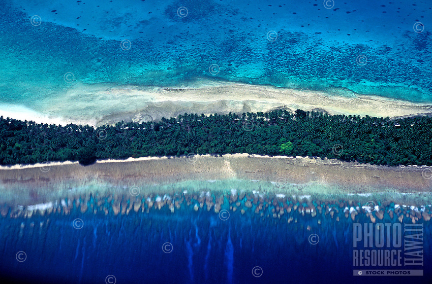 Interesting aerial shot of Mili Atoll, with a horizontal bands of trees, white sand beaches and coral reefs visible beneath the sparking blue Pacific Ocean.