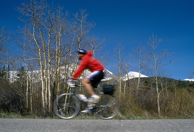 Cyclist along Peak to Peak Scenic & Historic Byway, near Estes Park, CO