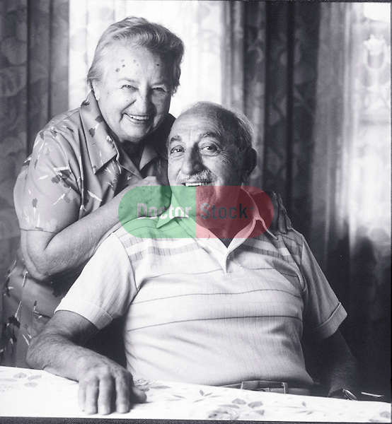 portrait of smiling elder couple at home