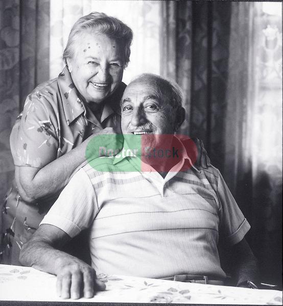 portrait of smiling elder couple at home