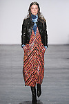 "Model Eliza walks runway in a sequin midi dress with Chevron Ikat motif, teal velvet turtleneck top and lambskin leather jacket with leather covered stud detail, from the Vivienne Tam Fall Winter 2016 ""Cultural Dreamland The New Silk Road"" collection, presented at NYFW: The Shows Fall 2016, during New York Fashion Week Fall 2016."