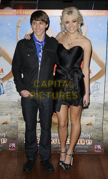 "LUCAS CRUIKSHANK & PIXIE LOTT (Victoria Louise Lott).""Fred: The Movie"" special screening, Vue West End cinema, Leicester Square, London, England..December 12th, 2010.full length black silk satin strapless dress sash jacket jeans denim hand in pocket grey gray print ankle strap shoes .CAP/CAN.©Can Nguyen/Capital Pictures."