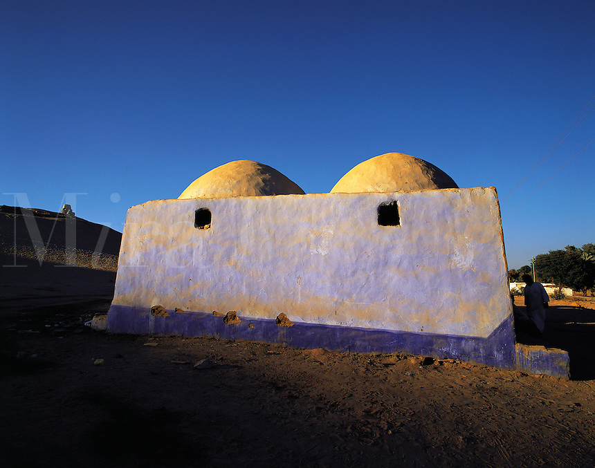 Evening light ona traditional blue-washed Nubian house near Aswan, Egyp