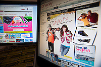 Back to school supplies are seen on the websites of JCPenney, right, and Staples on Monday, July 19, 2010. An estimated 30.8% of households will shop online this year compared with 22.2% last year. (© Richard B. Levine).