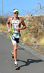 KAILUA-KONA, HI - OCTOBER 13:  Pete Jacobs of Australia on the marathon portion of the race during the 2012 IRONMAN World Championships on October 13, 2012 in Kailua-Kona, Hawaii. (Photo by Donald Miralle)