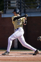 Catcher Ian Tompkins (32) of the Wake Forest Demon Deacons follows through on his swing versus the Clemson Tigers during the second game of a double header at Gene Hooks Stadium in Winston-Salem, NC, Sunday, March 9, 2008.