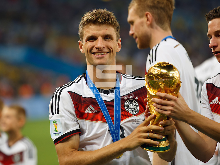 Thomas Muller of Germany celebrates by lifting the FIFA World Cup trophy