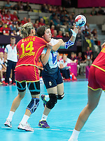 28 JUL 2012 - LONDON, GBR - Marie Gerbron (GBR) of Great Britain (centre, in white, blue and red) passes during the women's London 2012 Olympic Games Preliminary round handball match against Montenegro at The Copper Box in the Olympic Park, in Stratford, London, Great Britain (PHOTO (C) 2012 NIGEL FARROW)