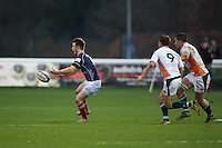 George Horne of London Scottish Football Club passes the ball during the Greene King IPA Championship match between London Scottish Football Club and Ealing Trailfinders at Richmond Athletic Ground, Richmond, United Kingdom on 26 December 2015. Photo by Alan  Stanford / PRiME Media Images