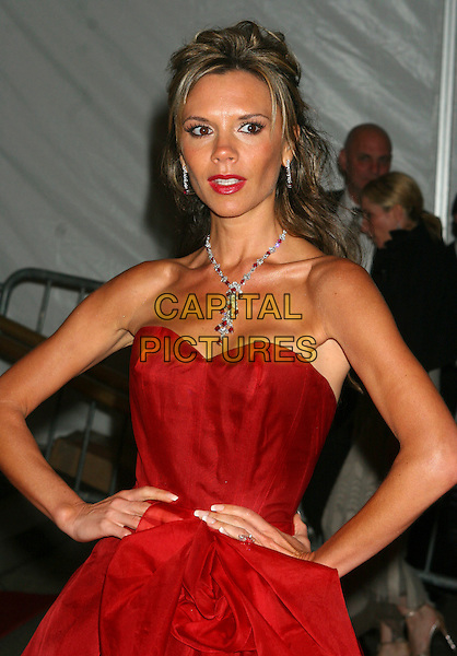 VICTORIA BECKHAM.Arrivals at The Costume Institute Gala, held at .The Metropolitan Museum of Art, New York - NY, USA,.01 May 2006..half length strapless red dress necklace diamonds lipstick bow hands on hips.Ref: IW.www.capitalpictures.com.sales@capitalpictures.com.©Ian Wilson/Capital Pictures
