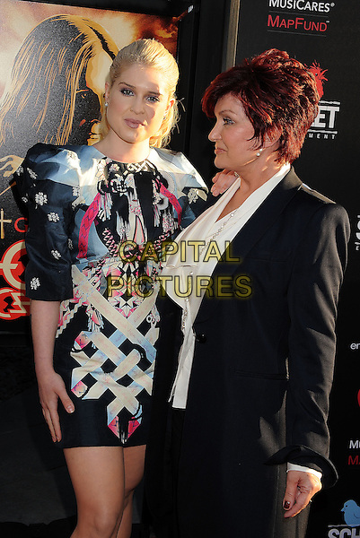Kelly Osbourne, Sharon Osbourne.'God Bless Ozzy Osbourne' Screening To Benefit The Musicares Map Fund held at the ArcLight Cinerama Dome, Hollywood, California, USA..August 22nd, 2011.half  length black grey gray pink dress print profile side tattoo jacket suit white mother mom mum daughter family  .CAP/ROT/TM.© TM/Roth/Capital Pictures