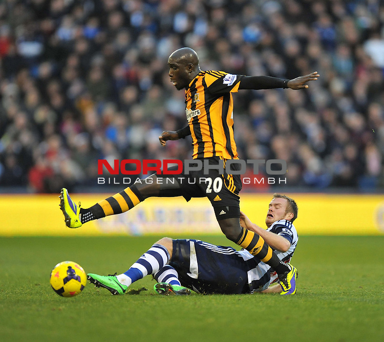Hull City's Yannick Sagbo gets tackled by West Bromwich Albion's Chris Brunt -  21/12/2013 - SPORT - FOOTBALL - The Hawthorns - West Bromwich - West Brom v Hull City - Barclays Premier League<br /> Foto nph / Meredith<br /> <br /> ***** OUT OF UK *****