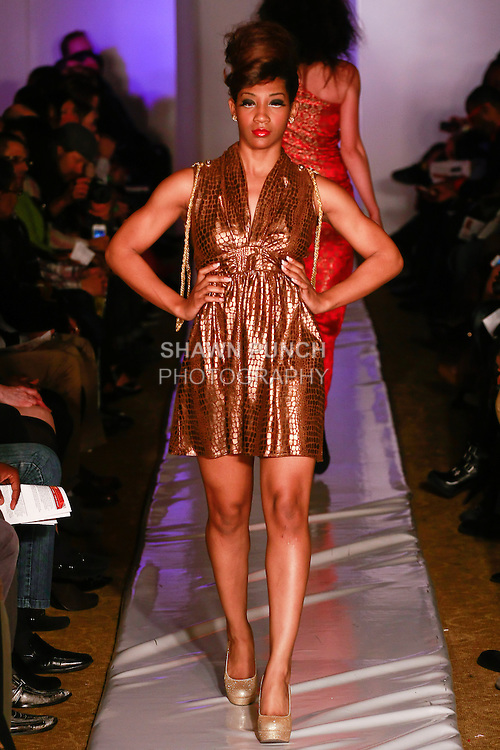 Model walks runway in an outfit from the Ola Style Fall 2012 collection by Ola Hawatmeh, during Plitzs Fashion Week New York Fall 2012.
