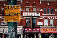 A bilingual Chinese-English sign is seen in Toronto Chinatown April 19, 2010. Toronto Chinatown is an ethnic enclave in Downtown Toronto with a high concentration of ethnic Chinese residents and businesses extending along Dundas Street West and Spadina Avenue.