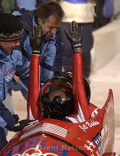 USA gold medalists Jill Bakken (front) and Vonetta Flowers celebrate their gold medal. Women's Bobsled, Tuesday evening at the Utah Olympic Park, 2002 Olympic Winter Games.; 02.19.2002, 6:29:24 PM<br />