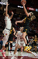 COLLEGE PARK, MD - FEBRUARY 13: Kathleen Doyle #22 of Iowa lobs a shot over Shakira Austin #1 of Maryland during a game between Iowa and Maryland at Xfinity Center on February 13, 2020 in College Park, Maryland.