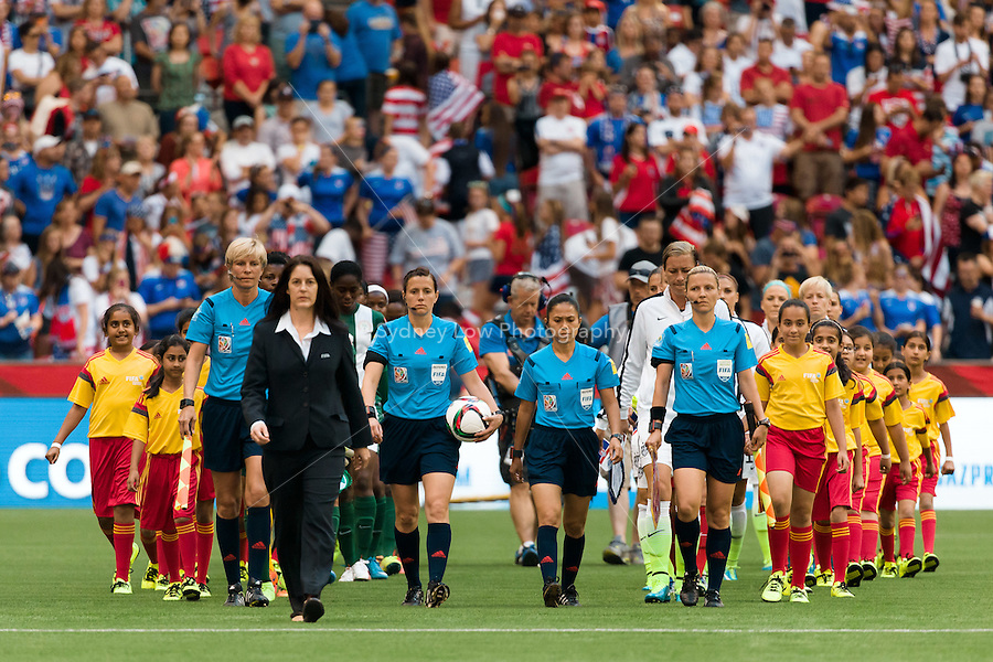June 16, 2015: The players enter the stadium for a Group D match at the FIFA Women's World Cup Canada 2015 between Nigeria and the USA at BC Place Stadium on 16 June 2015 in Vancouver, Canada. Sydney Low/Asteriskimages.com