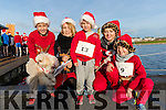 Max, Magda and Bruno Crzybowsky with Marta and Marcel Kovlowsk, pictured at the Santa Fun Run, in aid of Barretstown, starting from the Tralee Bay Wetlands, on Sunday last.