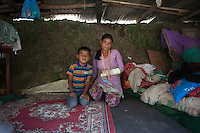 A victim of Nepal earthquake with her little brother in their temporary shelter house in Shila Porbot, outskirts of Kathmandu, Nepal. May 8, 2015
