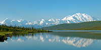 A perfectly clear and calm summer morning in Denali National Park.  Mt. McKinley and the Alaska Range reflect in the mirrow surface of Wonder Lake.