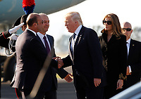 U.S. President Donald Trump, second from right, and his wife Melania, right, are welcomed by Italian Foreign Minister Angelino Alfano, left, after disembarking from Air Force One at Rome's Fiumicino international airport, May 23, 2017. Trump will meet Pope Francis, at the Vatican, and Italian President Sergio Mattarella, on May 24.<br /> UPDATE IMAGES PRESS/Riccardo De Luca