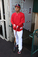 ANAHEIM - OCTOBER 9:  Maicer Izturis of the Los Angeles Angels of Anaheim gets ready in the dugout before Game 2 of the American League Division Series against the Boston Red Sox at Angel Stadium on October 9, 2009 in Anaheim, California. Photo by Brad Mangin