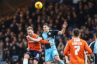 Danny Green of Luton Town and Matthew Bloomfield of Wycombe Wanderers in an aerial battle during the Sky Bet League 2 match between Luton Town and Wycombe Wanderers at Kenilworth Road, Luton, England on 26 December 2015. Photo by David Horn.