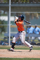 Baltimore Orioles Preston Palmeiro (57) follows through on a swing during a minor league Spring Training game against the Tampa Bay Rays on March 29, 2017 at the Buck O'Neil Baseball Complex in Sarasota, Florida.  (Mike Janes/Four Seam Images)