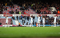 Sunday 07 December 2014<br /> Pictured L-R: Swansea players Kyle Bartley, Ki Sung Yueng, Ashley Williams, Wayne Routledge and Gylfi Sigurdsson applaud their supporters after the end of the game <br /> Re: Premier League West Ham United v Swansea City FC at Boleyn Ground, London, UK.