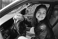 High school teen girl in her car