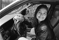 High school teen girl in her car
