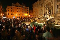 Rome continue to be one of the most visited city in the world..Roma continua ad essere una delle città più visitata al mondo.Tourist at Trevi fountain..Turisti alla Fontana di Trevi.
