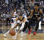 Nevada forward Cody Martin (11) beats San Diego State guard Devin Watson (0) to a loose ball  in the first half of an NCAA college basketball game in Reno, Nev., Saturday, Mar. 9, 2019. (AP Photo/Tom R. Smedes)