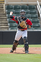 Kannapolis Intimidators catcher Brett Austin (20) makes a throw to first base against the Lakewood BlueClaws at CMC-Northeast Stadium on May 17, 2015 in Kannapolis, North Carolina.  The Intimidators defeated the BlueClaws 4-1.  (Brian Westerholt/Four Seam Images)
