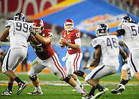 Jan. 1, 2011; Glendale, AZ, USA; Oklahoma Sooners quarterback (12) Landry Jones drops back to pass in the second half against the Connecticut Huskies in the 2011 Fiesta Bowl at University of Phoenix Stadium. Mandatory Credit: Mark J. Rebilas-.