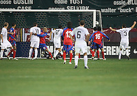 Players of the USA celebrate after Jonathan Bornstein #12 scored the tying goal against Costa Rica during a 2010 World Cup qualifying match in the CONCACAF region at RFK Stadium on October 14 2009, in Washington D.C.The match ended in a 2-2 tie.