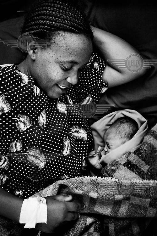 30 year old Christine Waweru with her newborn baby boy at the Ushirika Clinic in Kibera.