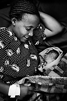 30 year old Christine Waweru with her newborn baby boy at the Ushirika Clinic in Kibera.