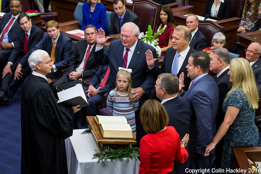 TALLAHASSEE, FLA. 11/22/16-Florida Supreme Court Justice Ricky Polston, left, administers the oath of office to Sen. Bill Montford, D-Tallahassee, Rep. Douglas Broxson, R-Gulf Breeze, George Gainer, R-Panama City, Sen. Aaron Bean, R-Fernandina Beach, and Rob Bradley, R-Fleming Island, during the 2016 organizational session at the Capitol in Tallahassee.<br /> <br /> COLIN HACKLEY PHOTO
