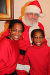 Actress and singer Rhonda Ross (Another World) and son Raif with Santa Claus - Hearts of Gold links to a better life celebrates Christmas with a party #2 for mothers and their children on December 17, 2016 in New York City, New York with arts and crafts, a great turkey dinner with all the goodies and then the children met Santa Claus and had a photo with him as he gave them gifts. (Photo by Sue Coflin/Max Photos)