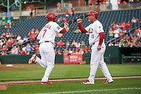 Springfield Cardinals second baseman Bruce Caldwell (7) fist bumps manager Dann Bilardello (11) after hitting a home run during a game against the Frisco RoughRiders  on June 3, 2015 at Hammons Field in Springfield, Missouri.  Springfield defeated Frisco 7-2.  (Mike Janes/Four Seam Images)