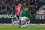 02.11.2019, wohninvest WESERSTADION, Bremen, GER, 1.FBL, Werder Bremen vs SC Freiburg<br /> <br /> DFL REGULATIONS PROHIBIT ANY USE OF PHOTOGRAPHS AS IMAGE SEQUENCES AND/OR QUASI-VIDEO.<br /> <br /> im Bild / picture shows<br /> Janik Haberer (SC Freiburg #19) im Duell / im Zweikampf mit Maximilian Eggestein (Werder Bremen #35), <br /> <br /> Foto © nordphoto / Ewert