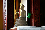 A statue of a seated Buddha sits inside the Ponchani Pavilion within the Royal Palace complex in Phnom Penh, Cambodia. The pavilion was originally built as a classical dance venue and now serves as place for royal meetings and receptions. Feb. 29, 2012.