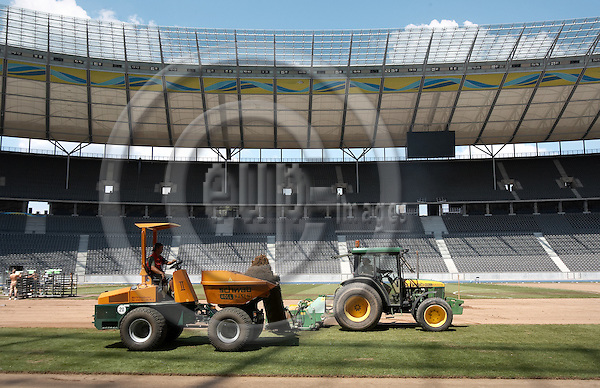 """BERLIN - GERMANY 11. JULY 2006 -- A german  post order company has bought the finale-grass in Berlins Olypiastadion and will sell between 40.000 and 60.000 pieces via the internet. The penalty piece has allready been sold for 4000,89 Euro - Two different offers stands on the internet, eather a piece on 30 x 40 centimer, which you can replant in your garten or a much smaller piece cast-in clear acrylic, both for the price of 75 Euro  -- PHOTO: CHRISTIAN T. JOERGENSEN / EUP & IMAGES..This image is delivered according to terms set out in """"Terms - Prices & Terms"""". (Please see www.eup-images.com for more details)"""