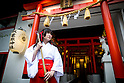 TOKYO, JAPAN - JUNE 27 : A shrine maiden posed for a portrait in front of the entrance of Akihabara shrine in Akihabara, Tokyo, Japan. June 27, 2016.  (Photo by Richard Atrero de Guzman/AFLO)