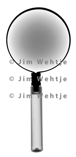 X-ray image of a magnifying glass (black on white) by Jim Wehtje, specialist in x-ray art and design images.