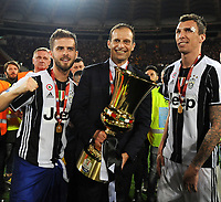 Football Soccer - Juventus - Lazio - Italian Cup Final - Olympic Stadium, Rome, Italy, May17,2017.<br /> Juventus' coach Massimiliano Allegri (c) Miralem Pjanic (l) and Mario Mandzukic (d) celebrate with the trophy after winning the Italian Cup Final match at Rome's Olympic stadium, on May 17, 2017.<br /> UPDATE IMAGES PRESS/Manuela Viganti